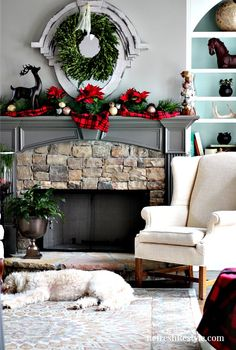 Christmas Mantel with real poinsettias and plaid at refreshrestyle.com