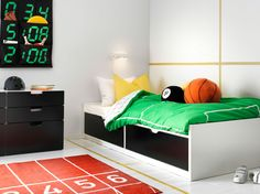 A black and white bedroom for sleep and play, featuring black and white FLAXA bed with built-in storage and STUVA chest in b/w