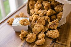 Little chicken pieces marinated in garlic and baked crispy golden brown, with a creamy parmesan-ranch dipping sauce!