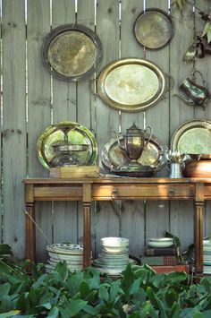 Tarnished silver trays on wall.