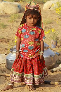 Rabari child. Gujarat The Rabaris are a migrating community who have been living in various regions of India for a millenia. They are identified by different names in different regions. The only commonality is the profession of cattle and camel raising.