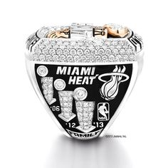 LeBron James and the Miami Heat received their 2013 championship rings last night before their season opener against the Chicago Bulls. The ring is flooded with 242 diamonds, 3 Onyx stones and weighs around 135 grams. Miami Heat Basketball, Nba Miami Heat, Love And Basketball, Basketball Season, Mami Heat, Miami Heat Championships, Nba Rings, King Lebron James, King James