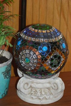 pretty glass mosaic garden sculpture..you can make this! Get a plastic kids ball and apply jewels