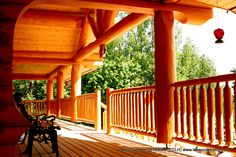 Custom Handcrafted Rancher style log home with country style covered post and beam deck Cabin Decks, Log Cabins, Rancher Homes, Cabin Hot Tub, Home Developers, Hot Tub Cover, Garage Door Installation, Cedar Log, Covered Decks