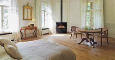 Le poêle gaz Podium par Richard Le Droff représente l'élégance pure. Ses lignes fines et simples mettent en avant une flamme douce et chaleureuse.