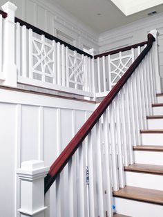 Gorgeous and unique wooden baluster system on this scissored staircase.