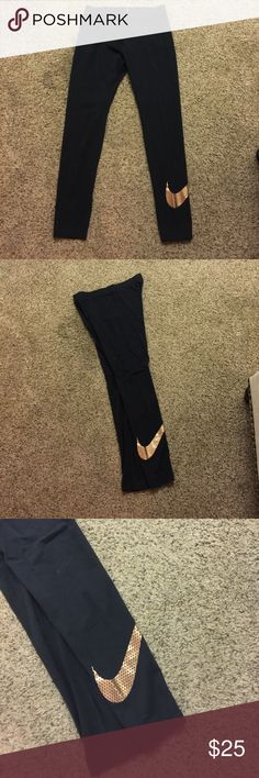 Nike leggings Excellent condition- worn once. Nike leggings with rose gold swoosh Nike Pants Leggings