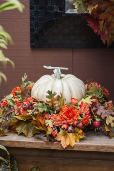Faux pumpkins!  http://rogersgardens.com/silks/