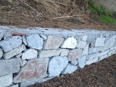 This is one of the best urbanite walls I've seen.  Turning some of the pieces on end so the flat, large side is visible was a nice choice.  Most of the time the pieces are just stacked and it looks fine but this version looks more like a stone wall.
