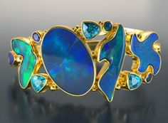 "Hinged Bracelet | Jack and Elizabeth Gaultieri.  ""Jeannie"". Australianblack opals, blue zircons and sapphires in 22kt yellow gold with 18kt ..."