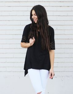 "Midnight Tee- We love the intricate detail on the sleeve of this top! The uneven sides add to our list of ""loves"" and give the shirt an effortless drape."