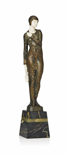 JOE DESCOMPS PATINATED AND COLD-PAINTED BRONZE AND IVORY FIGURE HOLDING A CLOSED FAN 'BEAUTY OF PARIS', CIRCA 1925, SIGNED JOE DESCOMPS, MARBLE AND ONYX PLINTH.