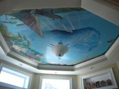 """great design used for an awkward ceiling layout.  """"Lion King""""  theme mural over a crib."""