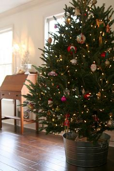 galvanized bucket for Christmas tree!    via Simple Thoughts