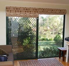 Split Sliding Door Roman Shades Pictures | Terrell Designs - not a fan of the fabric design, but these could work in our family room
