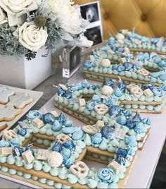 Baby Shower Letter Cake - - The letter cakes are climbing up the steps of popularity. Here is a lovely example - a great center piece for a baby shower party. Baby Shower Cakes For Boys, Baby Boy Cakes, Baby Boy Shower, Shower Party, Baby Shower Parties, Cake Decorated With Fruit, Fruits Decoration, Gateau Baby Shower, Alphabet Cake