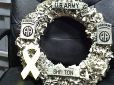 US Army wreath made with my hubbys name tabs a yellow ribbon and his unit and deployment patch:)