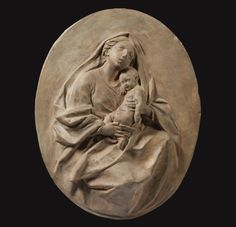 ITALIAN, ROME, FIRST HALF 18TH CENTURY, A TERRACOTTA OVAL RELIEF OF THE MADONNA AND CHILD, ON WOOD SUPPORT | © 2013 Sotheby's