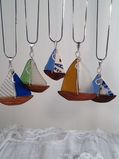 DISTINCTIVE SEA GLASS SAILBOAT PENDANT CREATED BY ARTIST GEOFFREY M. GOODMAN USING ONLY GENUINE CHESAPEAKE BAY SEA GLASS AND DRIFTWOOD. (ALSO