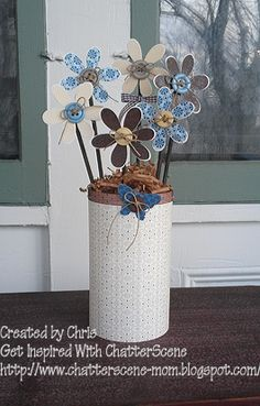 sweet,button, flowers in a vase- made from a Quaker oatmeal container and kitty litter.