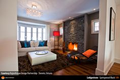 http://www.erthcoverings.com/Natural-Stone-Photos/img/Ledgestone/Ledgestone-Springwood-Black-18N-Living-Room-02.jpg