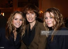 Actors Ashley (L) and Mary-Kate Olsen (R) pose with producer Gale Anne Hurd at the unveiling of the Hollywood Reporter's 10th Annual Women In Entertainment Power 100 list December 4, 2001 in Beverly Hills, CA. The event honors the top 100 women in the entertainment industry.