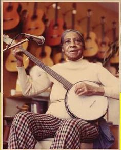 Elizabeth Cotton playing banjo.                                                                                                                                                                                 More