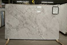 Super White Granite achieves the carrara marble look but is a stronger stone #LGLimitlessDesign #Contest