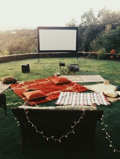 Brilliant idea - use your backyard for a summer movie screening with friends by renting a screen/projector and having everyone bring their own blankets/pillows and favorite movies