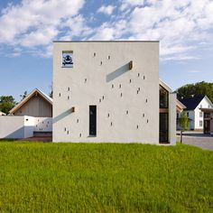 A square wall with a bell in one corner fronts this chapel for a spiritual retreat in Virginia by Dynerman Architects