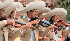 The Mariachi Cobre band appears in Mexico at Epcot.  This band has been appearing there since 1971.  There are 3 guitarists, 2 trumpet players and 7 violinists in the band.  The music they play is based on Mexican folklore.