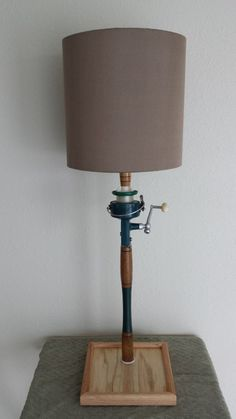 Fishing pole lamp antique fishing rod and reel lamp coastal lamp fishing pole lamp antique fishing pole table lamp coastal lamp beach lamp coastal decor beach decor nautical lamp nautical decor aloadofball Gallery
