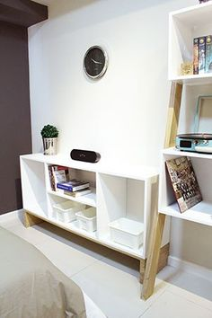 In front of the bed is a console table that can be topped with a flat-screen TV. It can also be used to store more belongings.