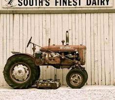 Farmall Tractor..taking a rest. I learned to drive stick shift on a Super C.