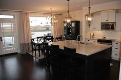 white cabinets, dark wood floors and love the lighting