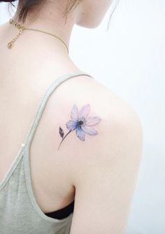 Beautiful bluish back shoulder tattoo by Banul