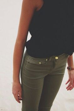 Black top and olive green pants.