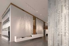 The headquarters of Ziba Design, a design consultancy in Portland. The lobby features an installation of employee names laser-cut from wafers of Styrofoam and hung vertically according to date hired.
