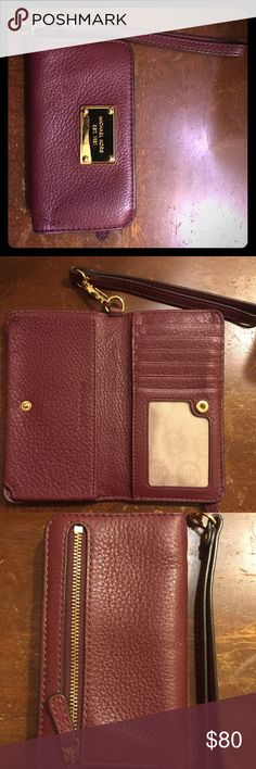 Pre-loved Michael Kors Burgundy Leather Wallet Pre-loved Michael Kors Burgundy Leather Cell Phone Wallet.  Fits an IPhone 6.  Bought at Nordstrom.  Only has a small scratch on the Michael Kors label in the front (see picture).  Only used a handful of times.  Very soft leather.  I now have a larger phone so I am no longer able to use it. Michael Kors Bags Wallets