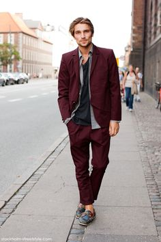 Shop this look for $187:  http://lookastic.com/men/looks/boat-shoes-and-blazer-and-chinos-and-longsleeve-shirt-and-crew-neck-t-shirt/570  — Navy Leather Boat Shoes  — Burgundy Blazer  — Burgundy Chinos  — Grey Longsleeve Shirt  — Black Crew-neck T-shirt