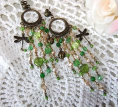 Faboo with cute buggy charms and green glass.....from mockidesign at Etsy, Monica Rangne