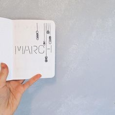 Bullet journal monthly cover page, March cover page, hanging lightbulb drawing. | @beardot_