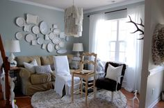 The chandelier is cool but that plate wall makes me drool! Would be awesome with mirrors too!!!