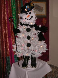 White Christmas Tree Decorations Snowman December 10th, 2014  I made him from stuff around the house, only took me an hour from start to finish. I made his face and buttons from felt my hat, gloves, scarf, and boot's oh and one of my belly dance canes. LOL