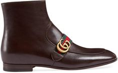 """Leather boot with Double G. The leather ankle boot is designed with a sleek construction and elongated toe. Distinguished by a strap across the front with House Web stripe and Double G hardware. Brown leather Green and red Web strap with Double G hardware Side zipper Leather sole .6"""" heel height Made in Italy"""