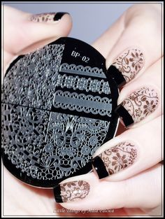 Elegant Lace Stamping Nails : http://little-things-by-mala-palccica.blogspot.com/2015/02/negative-space-manicure-with-born-prety.html