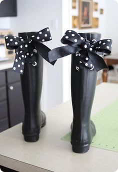 This is how I want to roll... add big grommets to the back of your wellies and tie big bows with beautiful ribbon... wouldn't I look cute feeding the chickens and slopping the hogs in these babies...