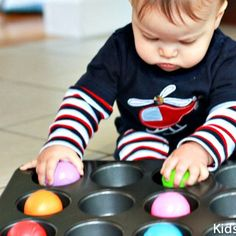 Muffin Tin Fun - plus 19 other fun activities for your 1-year old.  Also dye spaghetti different colors and let baby explore the cooked noodles.  Explore a bowl of coffee beans, sand, salt.  All with supervision of course.