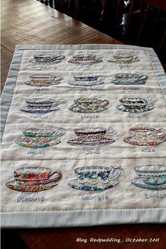Tea cup table runner.  Mix of appliqué and embroidery.  There are close ups of the tea cups and instructions for appliqué.  Individual cups would be very nice on a mug rug and tea cozy.