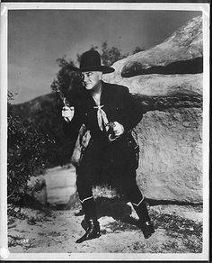 Hopalong Cassidy, guns drawn